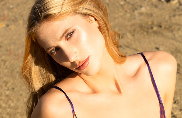 Blonde woman looking up at camera